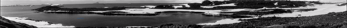 Black and White panorama derived from panning shot. Frank Hurley, Home of the Blizzard, 1913.
